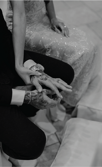 groom-and-bride-holding-hands-tattoos.pn