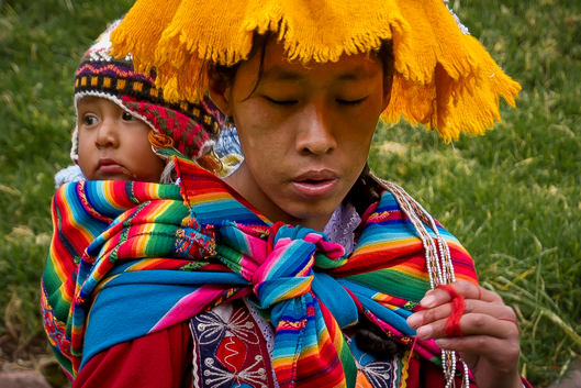 Woman carrying child - Traditional dress