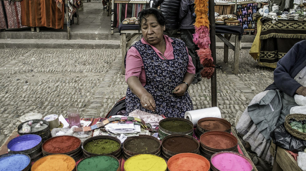 Woman selling dyes in Pisac Market