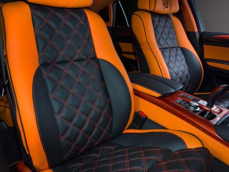 BMW: перетяжка салона оранжевой и черной кожей
