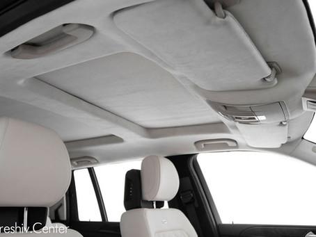 Перетяжка салона Mercedes GL белой кожей и алькантарой.
