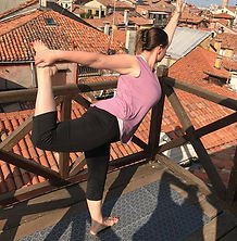 Yoga teacher in Dancer pose