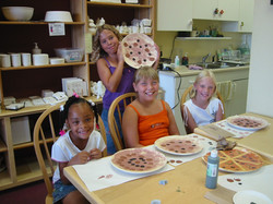 class girls painting pizza plate