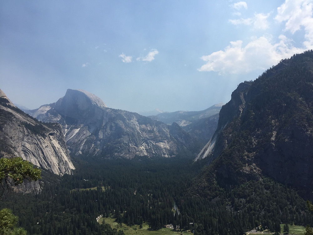 Hiking in the mountains in CA. Half Dome in the distance.