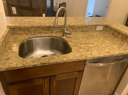 Granite sink with offset faucet