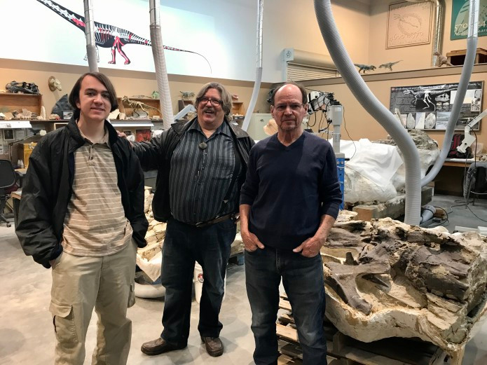 James Pinto, Jim Kirkland, and Scott Madsen standing in a fossil prep lab.