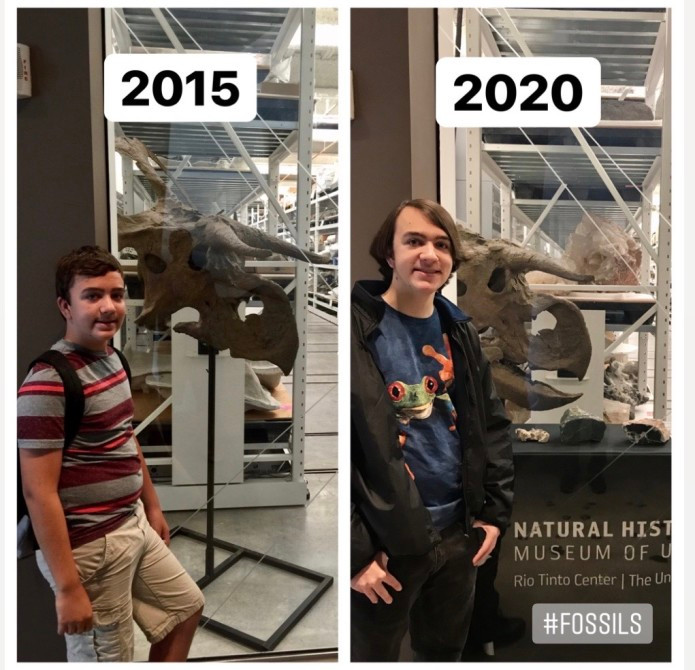 James Pinto standing in front of a fossil display at NHMU.