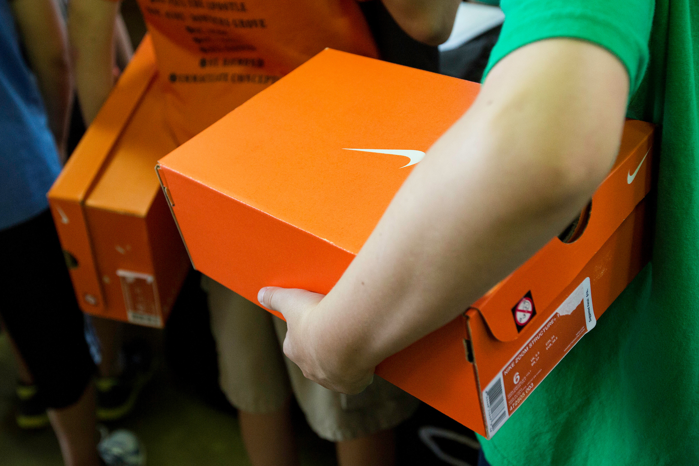 Campers receiving their free Nike shoes