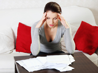 Getting Out of Debt: The Pros & Cons of Debt Settlement