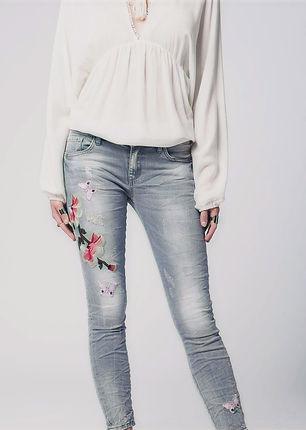 Gray_slim_denim_embroidered_jeans_qoLh20
