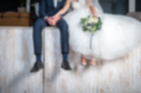 Beautiful wedding couple sitting on wood