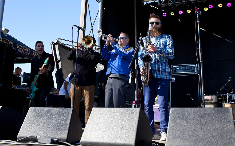 Reel Big Fish performing on stage with Goldfinger. Also picture:  Mike Herrera on bass / Jarnard Sutton