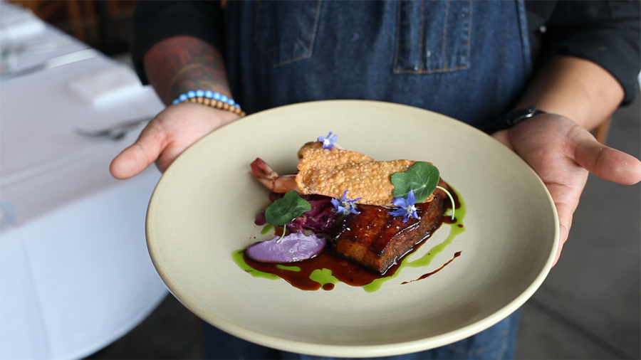 Slow roasted pork belly, butter poached Mexican prawns, purple cabbage, pickled raisins, molasses glaze, house made old bay crackers photo by Jarnard Sutton