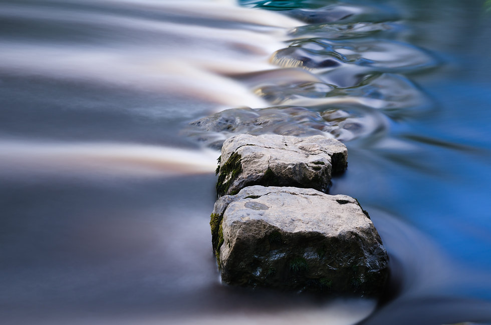 Cool blue stepping stones in a river.jpg