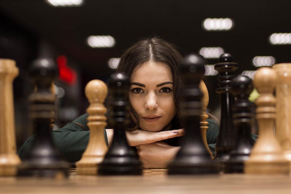 beautiful girl playing chess.jpg