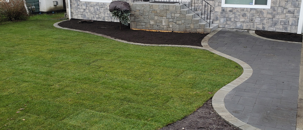 small patio entrance and sod install