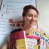 Murt smiling with books.jpg