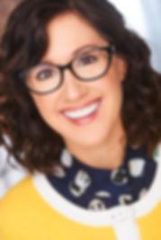 Yellow sweater Headshot.jpg