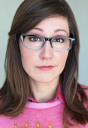 Pink shirt and glasses headshot.jpg