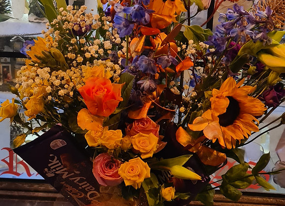 Florist choice large Aqua bouquet in a glass or ceramic vase