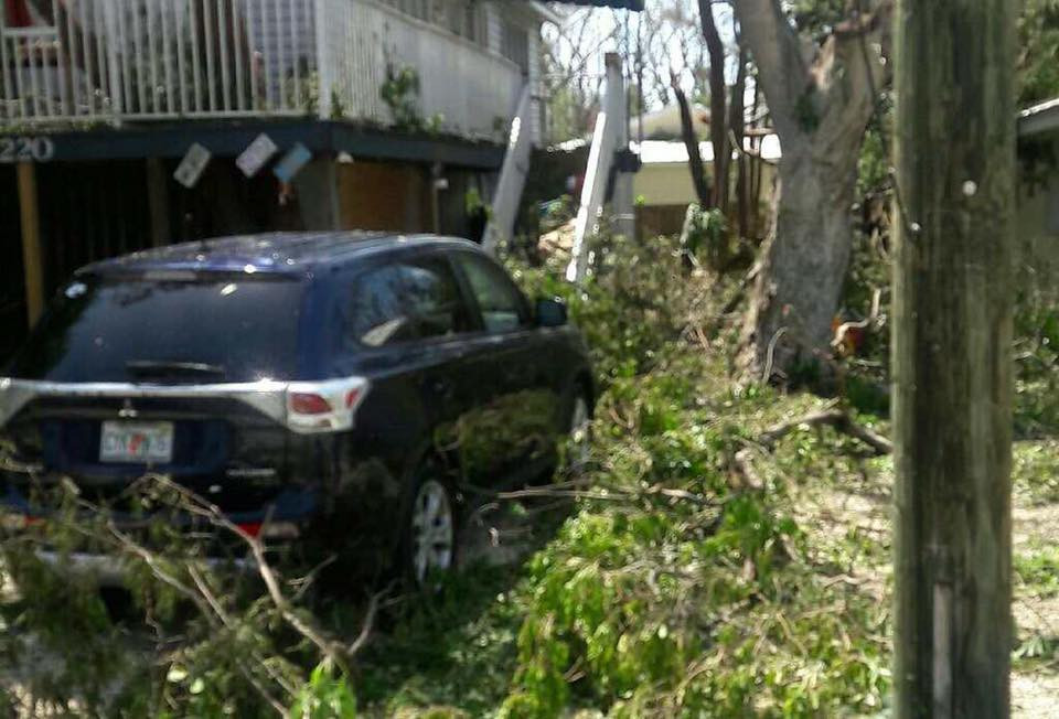 Our car and the front and side of our house when we arrived