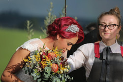 Buds n Roses - bride carrying native flo