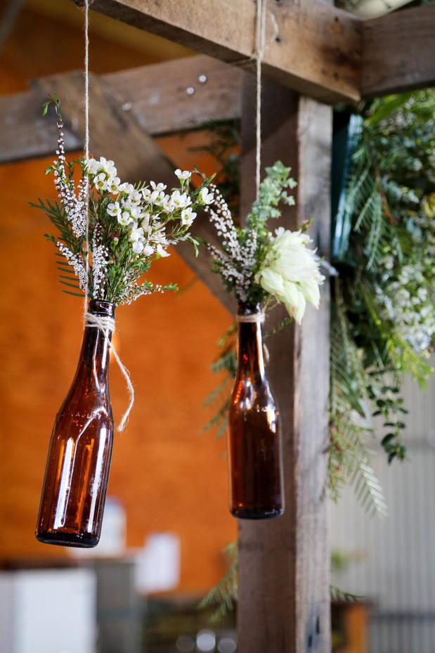Buds n Roses - ceremony hanging bottles