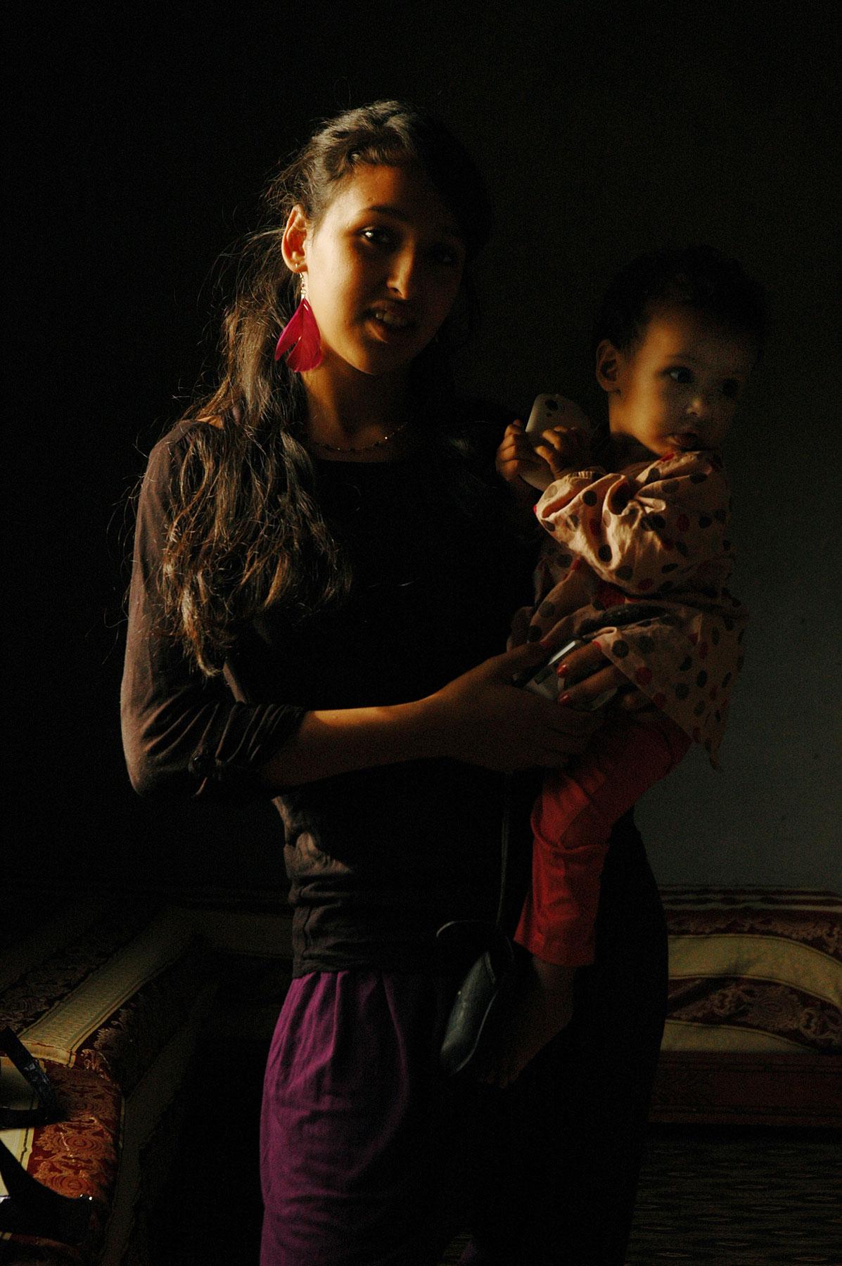 Fatima et l'enfant, photographie, 2013