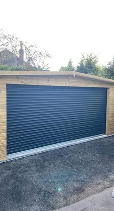 Navy blue new garage door fitted