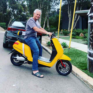 Yellow Zoom Electric moped scooer