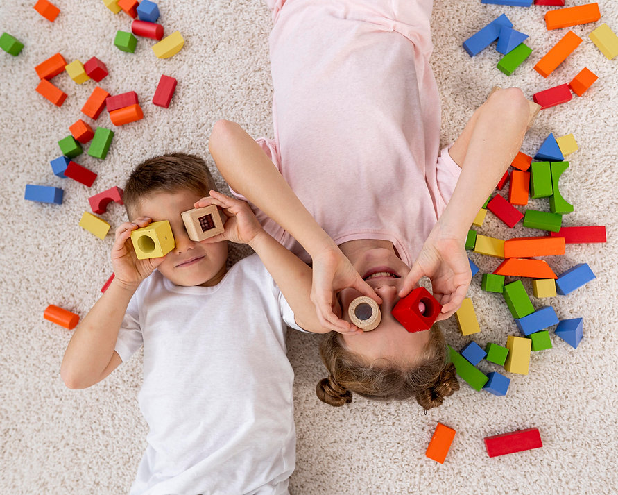 top-view-non-binary-kids-playing-with-a-