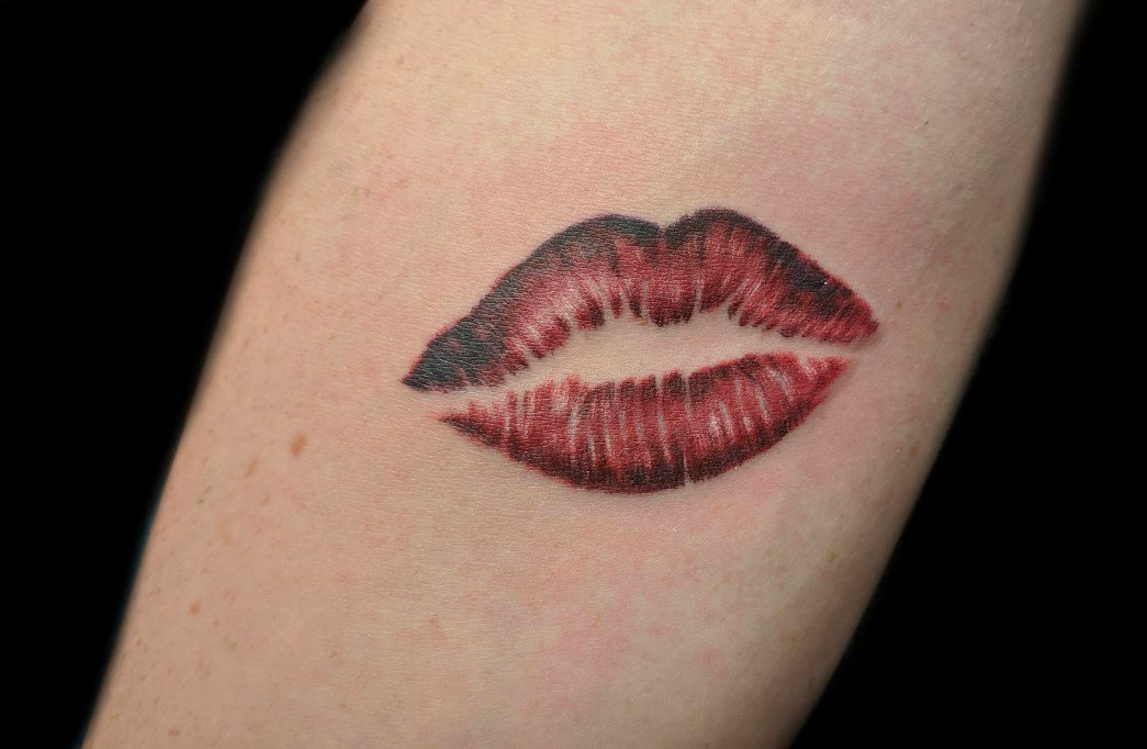 lip prints on arm