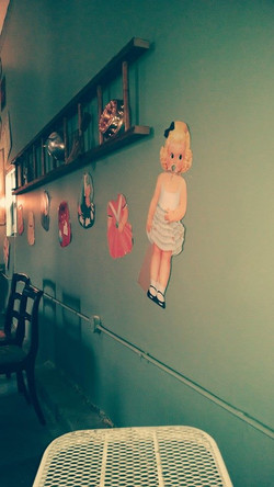 Ladders and dolls wall