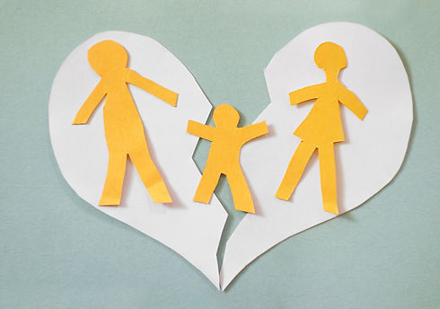 Paper cutout family split apart on a pap