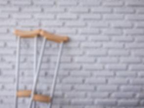 crutch on the white brick wall.jpg