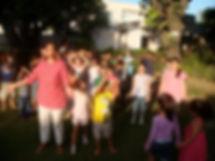 Jyoti with kids practiing Siddhanath Surya