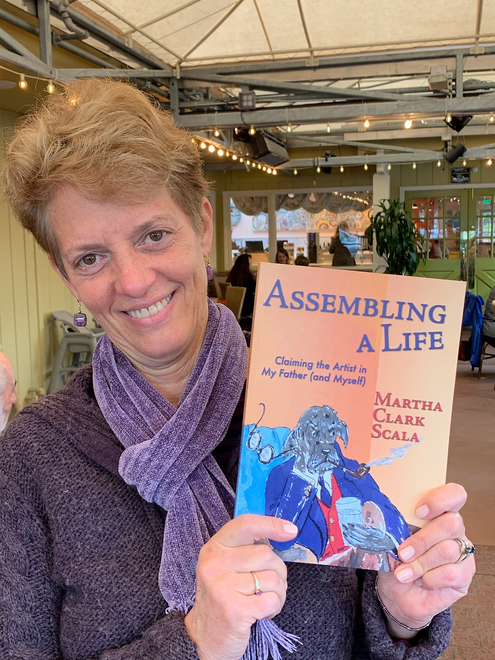 Author Martha Clark Scala with her new memoir, Assembling a Life