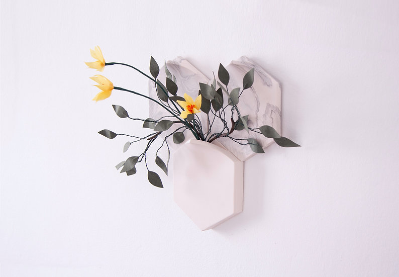 Marbled tiles with modular wall-mount vase