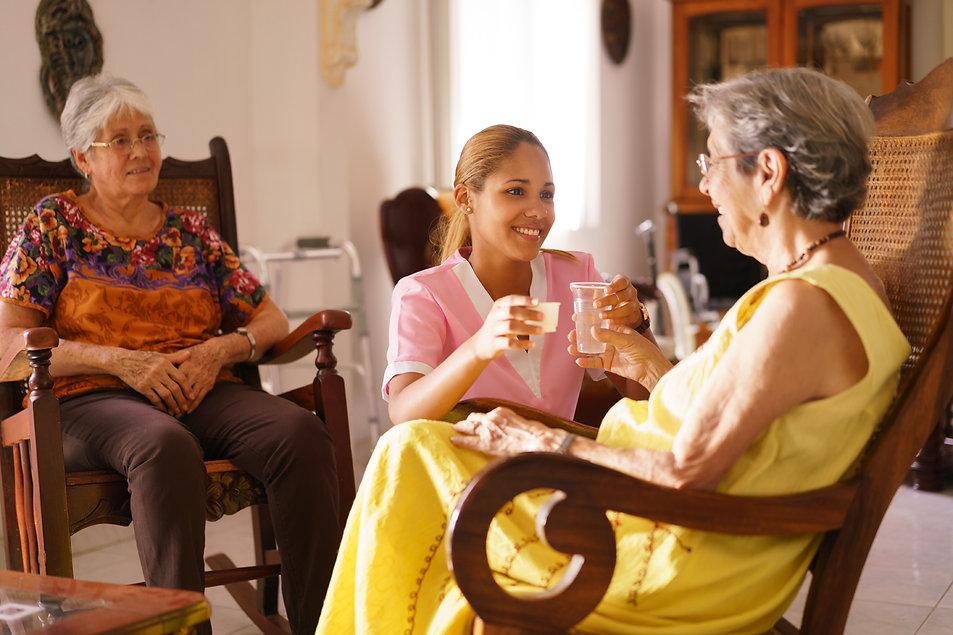 hospice-nurse-serving-pill-medicine-wate