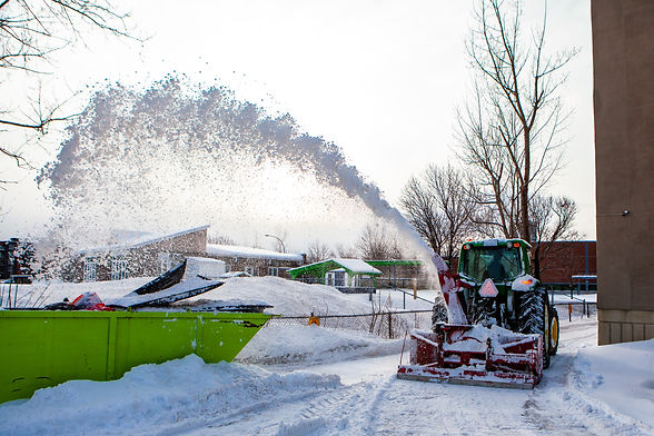 Snowblower tractor clearing snow. Red sn