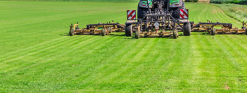 Industrial lawn mower cutting the grass