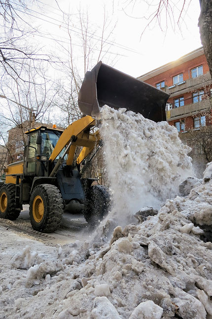 Cleaning the streets of snow, tractor cl