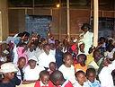 Children raise hands.JPG