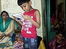 corraya slum boy read.jpg