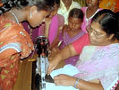 woman learing to sew USE.jpg