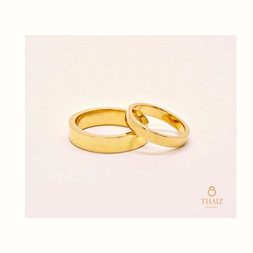 18k Gold Rings 4mm wide ring for him & 3mm for her. Simple flat shaped.