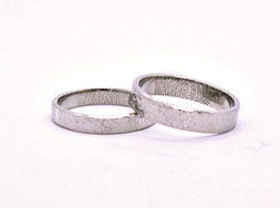 18k White Gold Rings. 5 and 4mm wide flat bands. Hammered texture and fine polish finish. Hand-engraved inside: Couples fingerprints.