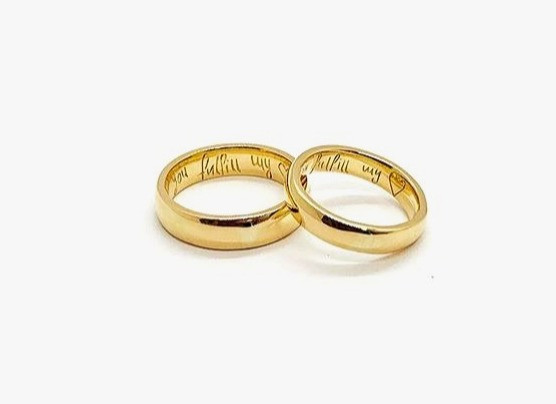 "18k Yellow Gold Rings, half round Band, 5mm wide for him and 3mm for her.  Hand engraved inside with bride's handwritting: ""You fulfill my heart""."