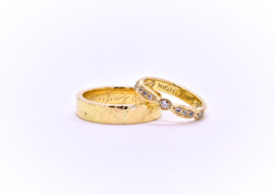 """18k Yellow Gold Rings: 5mm wide hammered texture for him & 3mm wide for her, set with white sapphires. Inside hand engraved: """"Ewig mein, Ewig dein"""""""