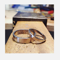 18k White Gold Rings, flat Band, 4mm wide for him and 2mm wide for her.  Hand-engraved inside: Couples fingerprints.